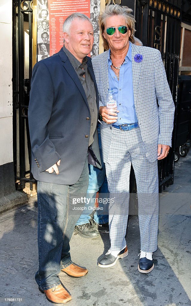 Rod Stewart (R) poses with a fan at Brits Icon Awards honouring Sir Elton John at London Palladium on September 2, 2013 in London, England.