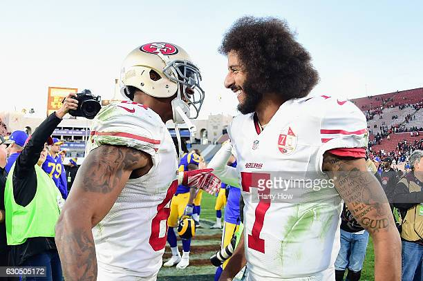 Rod Streater and Colin Kaepernick of the San Francisco 49ers celebrate after defeating the Los Angeles Rams 2221 at Los Angeles Memorial Coliseum on...
