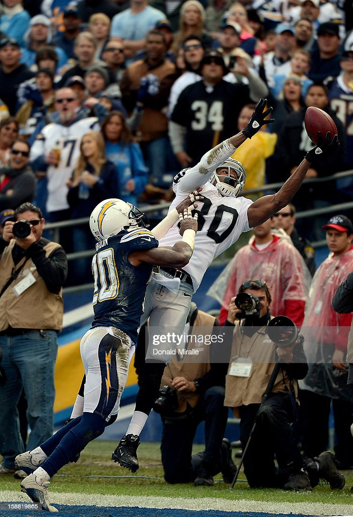 Rod Streater #80 of the Oakland Raiders jumps to catch the ball against Antoine Carson #20 of the San Diego Chargers on December 30, 2012 at Qualcomm Stadium in San Diego, California.