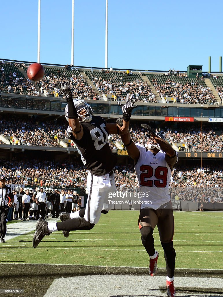Rod Streater #80 of the Oakland Raiders reaches out but can't come up with the catch in the endzone over Leonard Johnson #29 of the Tampa Bay Buccaneers during the first quarter of an NFL football game at O.co Coliseum on November 4, 2012 in Oakland, California.