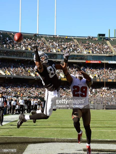 Rod Streater of the Oakland Raiders reaches out but can't come up with the catch in the endzone over Leonard Johnson of the Tampa Bay Buccaneers...