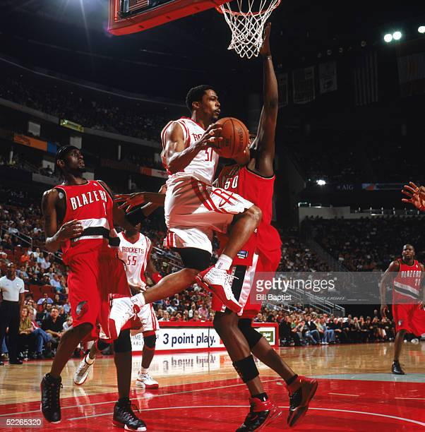 Rod Strickland of the Houston Rockets looks to pass as he drives under the basket during a game against the Portland Trail Blazers at Toyota Center...