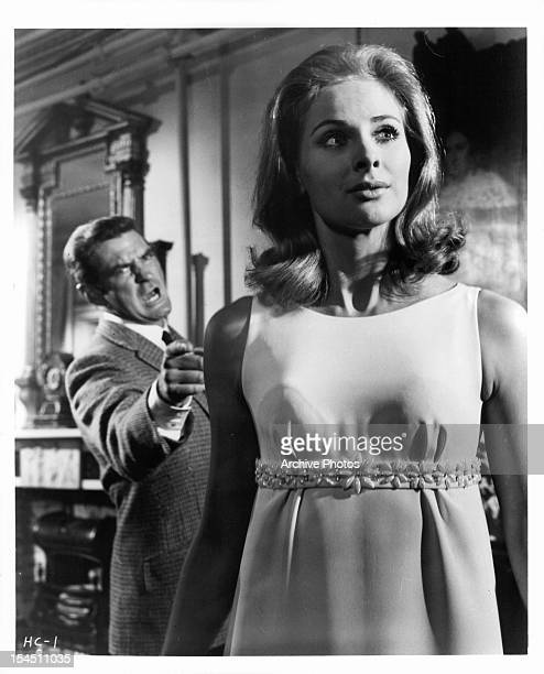 Rod Taylor points and yells at Penelope Horner in a scene from the film 'The Man Who Had Power Over Women' 1970