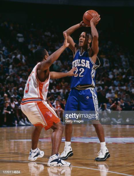 Rod Thompson, Guard for the University of Tulsa Golden Hurricane prepares to pass over Terrell McIntyre of the Clemson University Tigers during the...