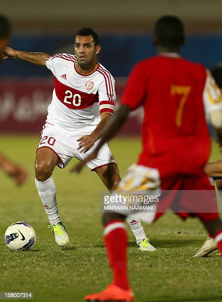 Roda Antar of Lebanon attempts to pass the ball as Qasim Hardan of Oman defends during their football match in the 7th West Asia Football Federation...