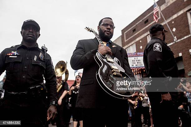 Rodd Bland, son of blues legend Bobby Bland, carries Lucille, one of B.B. King's beloved guitars, at the front of the processional down Beale Street...