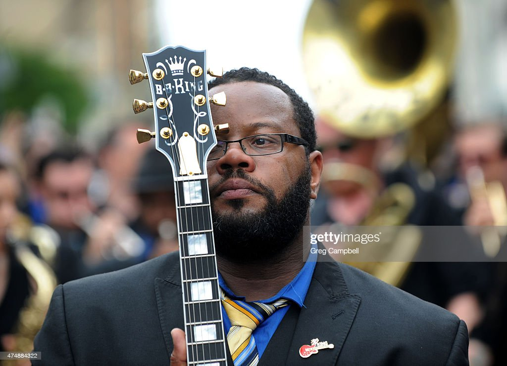 Rodd Bland, son of Bobby 'Blue' Bland, carries 'Lucille' during the funeral procession down Beale Street in honor of B.B. King on May 27, 2015 in Memphis, TN. King passed away on May 14, 2015 at the age of 89.
