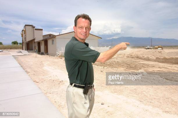 Rodd Buckle Director of Marketing points to where a golf course will be built and an airstrip and rooms for 25 prostitutes at Sheri's Ranch a brothel...