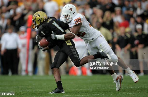 Roddrick Muckelroy of the Texas Longhorns tackles Josh Smith of the Colorado Buffaloes on a punt return at Folsom Field on October 4 2008 in Boulder...