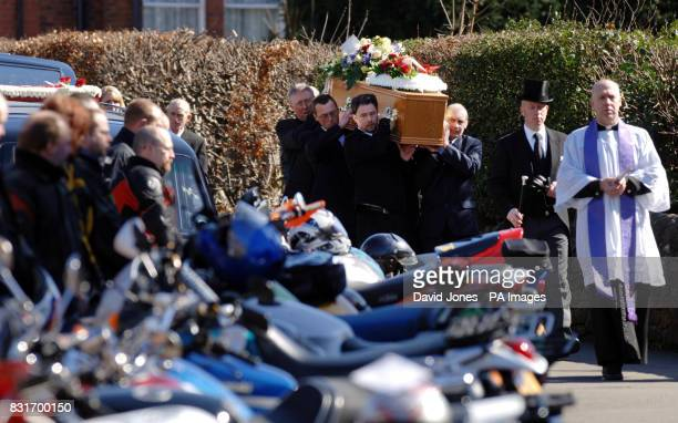 Roddy Hine's coffin is carried into All Saints Church Leek Staffordshire past a line of his fellow bikers Tuesday April 4 2006 Mr Hine and his...