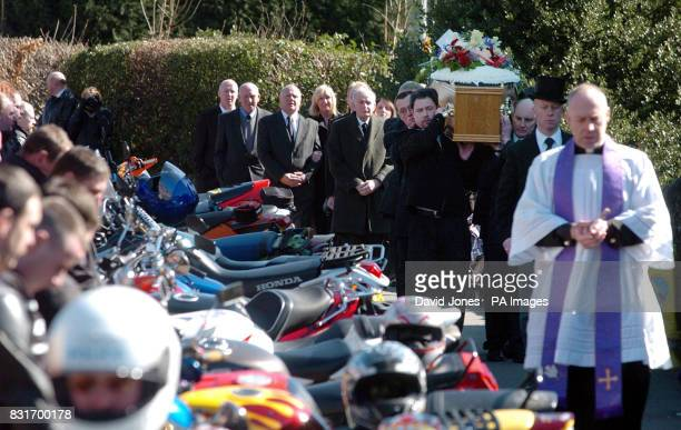 Roddy Hine's coffin is carried into All Saints Church Leek Staffordshire past a line of his fellow bikers and followed by his partner Mandy Carter...