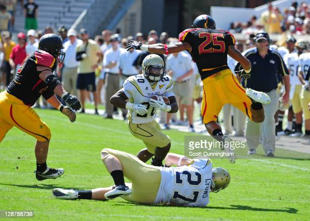 Roddy Jones the Georgia Tech Yellow Jackets carries the ball against Dexter McDougle of the Maryland Terrapins at Bobby Dodd Stadium on October 8,...