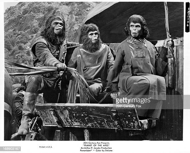 Roddy McDowall and Kim Hunter ride a cart in a scene from the film 'Planet Of The Apes' 1968