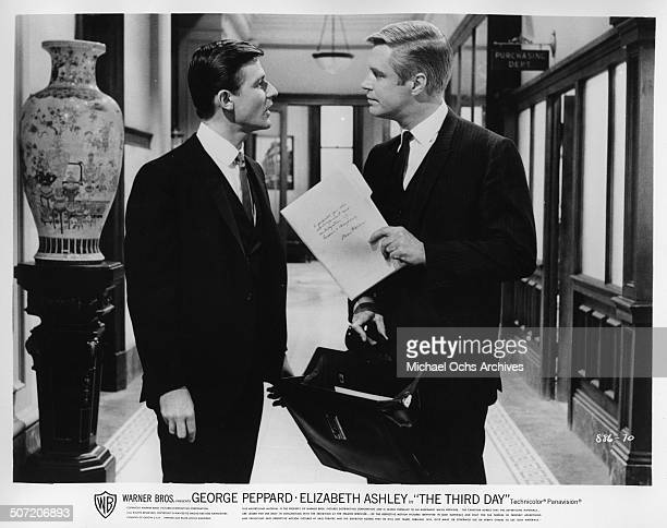 """Roddy McDowall argues with George Peppard about business matters in a scene from the Warner Bros. Movie """"The Third Day"""", circa 1965."""