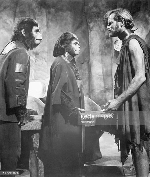 Roddy McDowell Kim Hunter and Charlton Heston act in the movie Planet of the Apes McDowell and Hunter wear ape costumes