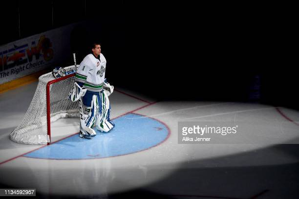 Roddy Ross of the Seattle Thunderbirds stands in the spotlight during player introductions before the game against the Victoria Royals at the accesso...