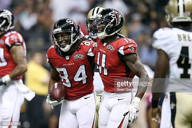 Roddy White is congratulated by Julio Jones of the Atlanta Falcons following a touchdown in the second quarter of a game against the New Orleans...