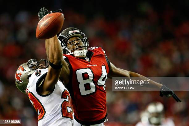 Roddy White of the Atlanta Falcons fails to pull in this reception against Leonard Johnson of the Tampa Bay Buccaneers at Georgia Dome on December 30...