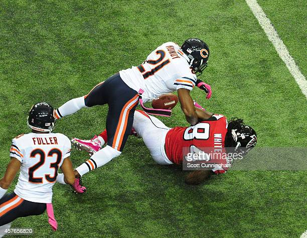 Roddy White of the Atlanta Falcons has the ball knocked loose on a hit by Ryan Mundy of the Chicago Bears at the Georgia Dome on October 12 2014 in...