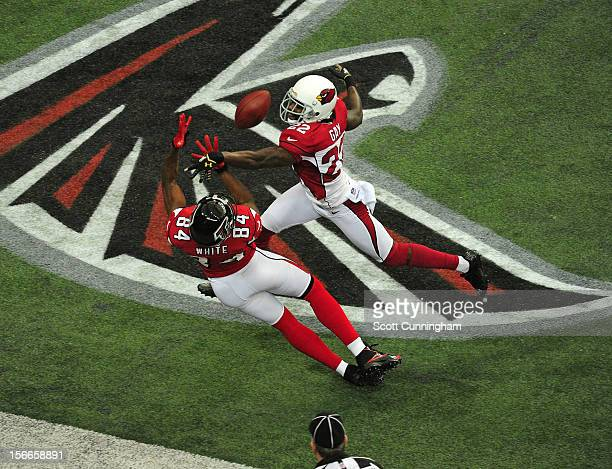 Roddy White of the Atlanta Falcons makes a catch against William Gay of the Arizona Cardinals at the Georgia Dome on November 18 2012 in Atlanta...