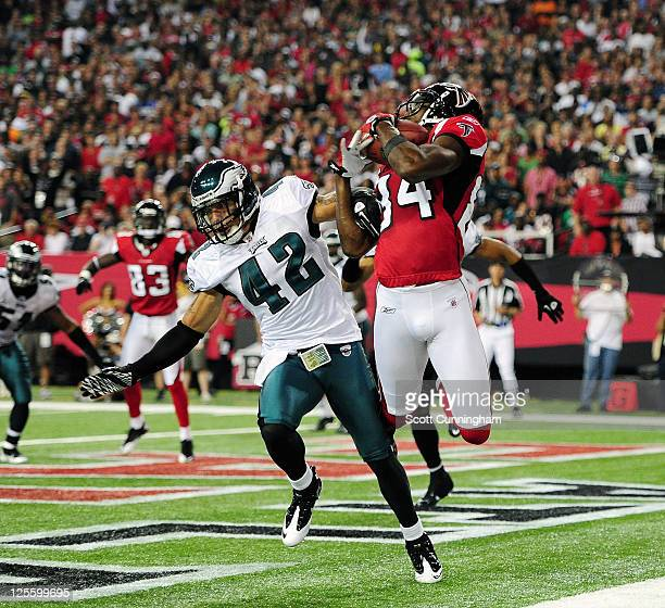 Roddy White of the Atlanta Falcons makes a catch for a touchdown against Kurt Coleman of the Philadelphia Eagles at the Georgia Dome on September 18...