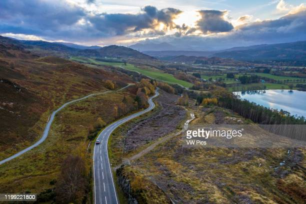 A rode cuts through the hills near Loch Ness in Scotland United Kingdom