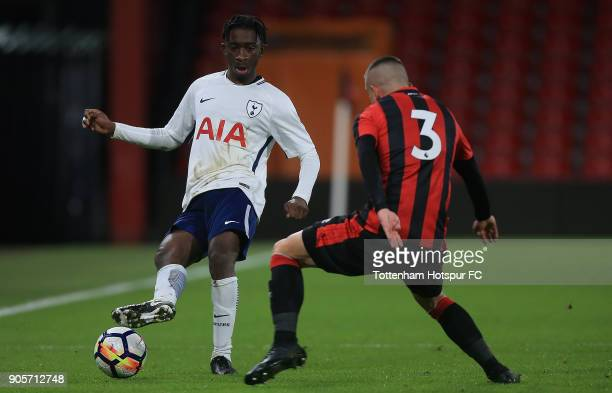Rodel Richards of Tottenham Hotspur passes under pressure from Connal Morrison of Bournemouth during the FA Youth Cup match between Bournemouth U18...