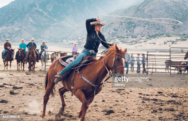 Rodeo Action Cowgirl Chasing Bull with Lasso in Arena