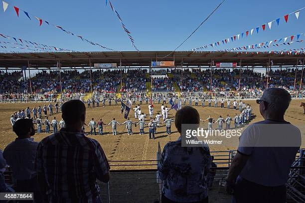 Angola Prison Rodeo Overall view of participants praying before competition at Louisiana State Penitentiary St Francisville LA CREDIT William Widmer