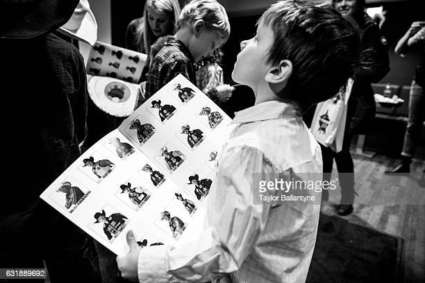 Buck Off at the Garden: Portrait of young fan seeking autographs backstage during photo shoot before event at Madison Square Garden. Behind the...