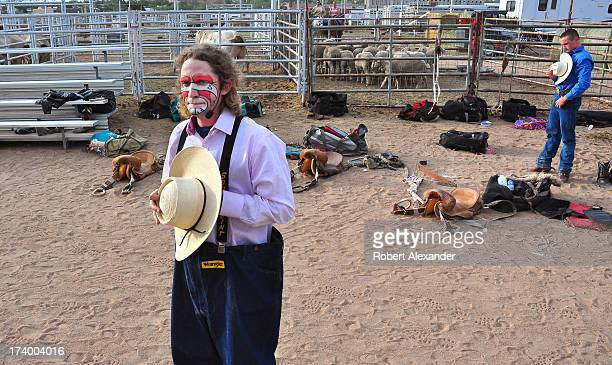 A rodeo clown holds his hat over his heart during the singing of the National Anthem before competition begins at the 2013 Rodeo de Santa Fe in Santa...