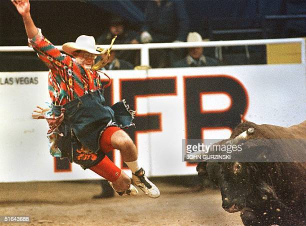 Rodeo clown Ray Wiley is tossed into the air after being hit by the Bull Ice Pick during the 5th goround of the Bull Fighting Event at the National...