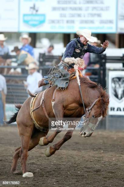 Rodeo cowboy Dylan Henson from Bloomfield NM scored a 725 in the Saddle Bronc competition riding the horse Boogers Pet on August 24 2017 in Bremerton...