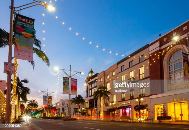 rodeo drive at night, beverly hills, ca - beverly hills stock pictures, royalty-free photos & images