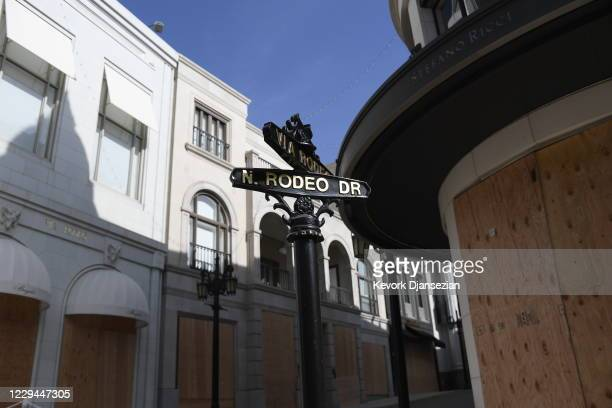 Rodeo Drive in Beverly Hills, California, is closed for pedestrian and vehicular traffic and designer stores are boarded up in preparation for...