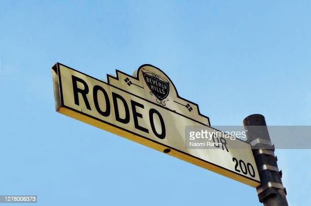 rodeo drive street sign on a sunny day - los angeles, california - beverly hills california stock pictures, royalty-free photos & images