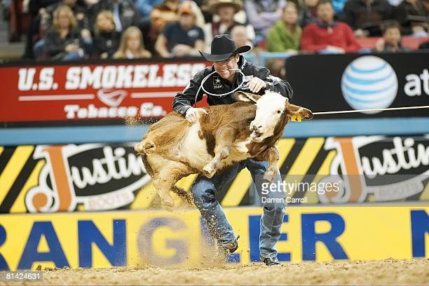 Rodeo National Finals Rodeo Trevor Brazile in action securing calf during 9th Round of Tiedown Roping Event at Thomas Mack Center Brazile became 1st...