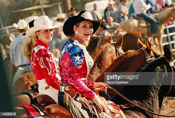 rodeo queens riding in pageant, smiling - beauty queen stock pictures, royalty-free photos & images