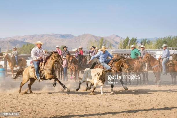 Rodeo Riding Action Cowboys Chasing Bull