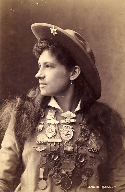 US rodeo star Annie Oakley the highly skilled trick...