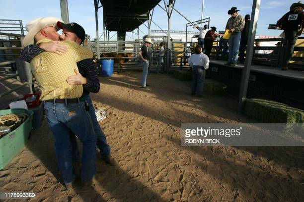 Rodeo students Brian Treadway and Ray Ostmann kiss during a class in chute dogging at the twoday rodeo school organized by the Arizona Gay Rodeo...