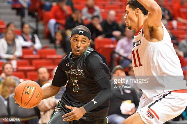 Roderick Bobbitt of the Hawaii Warriors drives around Zach Smith of the Texas Tech Red Raiders during the game on November 28 2015 at United...