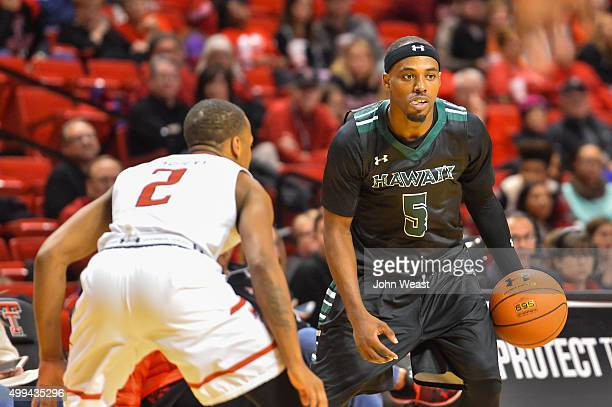 Roderick Bobbitt of the Hawaii Warriors handles the ball against Devon Thomas of the Texas Tech Red Raiders during the game on November 28 2015 at...