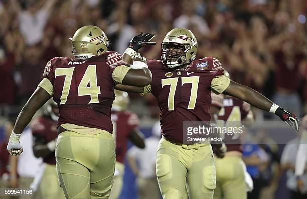 Roderick Johnson and Derrick Kelly II of the Florida State Seminoles celebrate in the second half against the Mississippi Rebels during the Camping...