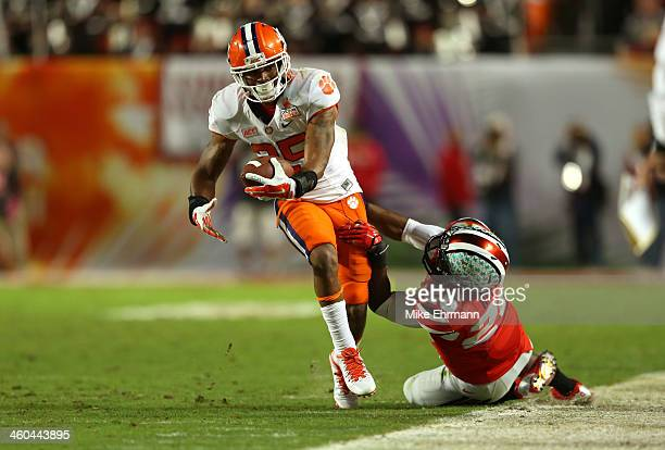 Roderick McDowell of the Clemson Tigers tries to convert a fourth down against Armani Reeves of the Ohio State Buckeyes in the second quarter during...