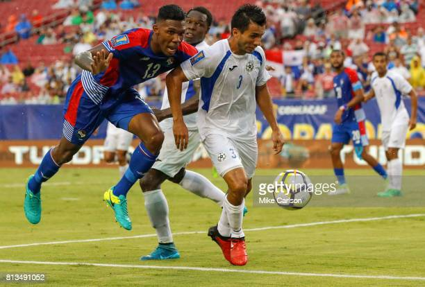 Roderick Miller of Panama reaches for the ball past the defense of Manuel Rosas of Nicaragua during the first half of the CONCACAF Group B match at...