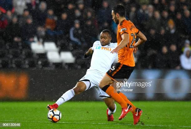 Roderick Miranda of Wolverhampton Wanderers tackles Jordan Ayew of Swansea City during The Emirates FA Cup Third Round Replay between Swansea City...