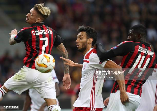 Roderick of Olympiacos FC competes for the ball with Tiemoue Bakayoko and Samuel Castillejo of AC Milan during the UEFA Europa League Group F match...