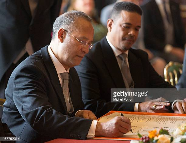 Roderick Pieters Minister Plenipotentiary of Curacao signs the Act of Abdication of Queen Beatrix of the Netherlands in the Moseszaal at the Royal...