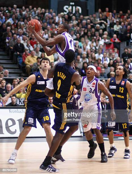 Roderick Trice of Goettingen Blagota Sekulic and Ansu Sesay battle for the ball during the Basketball Bundesliga match between MEG Goettingen and...